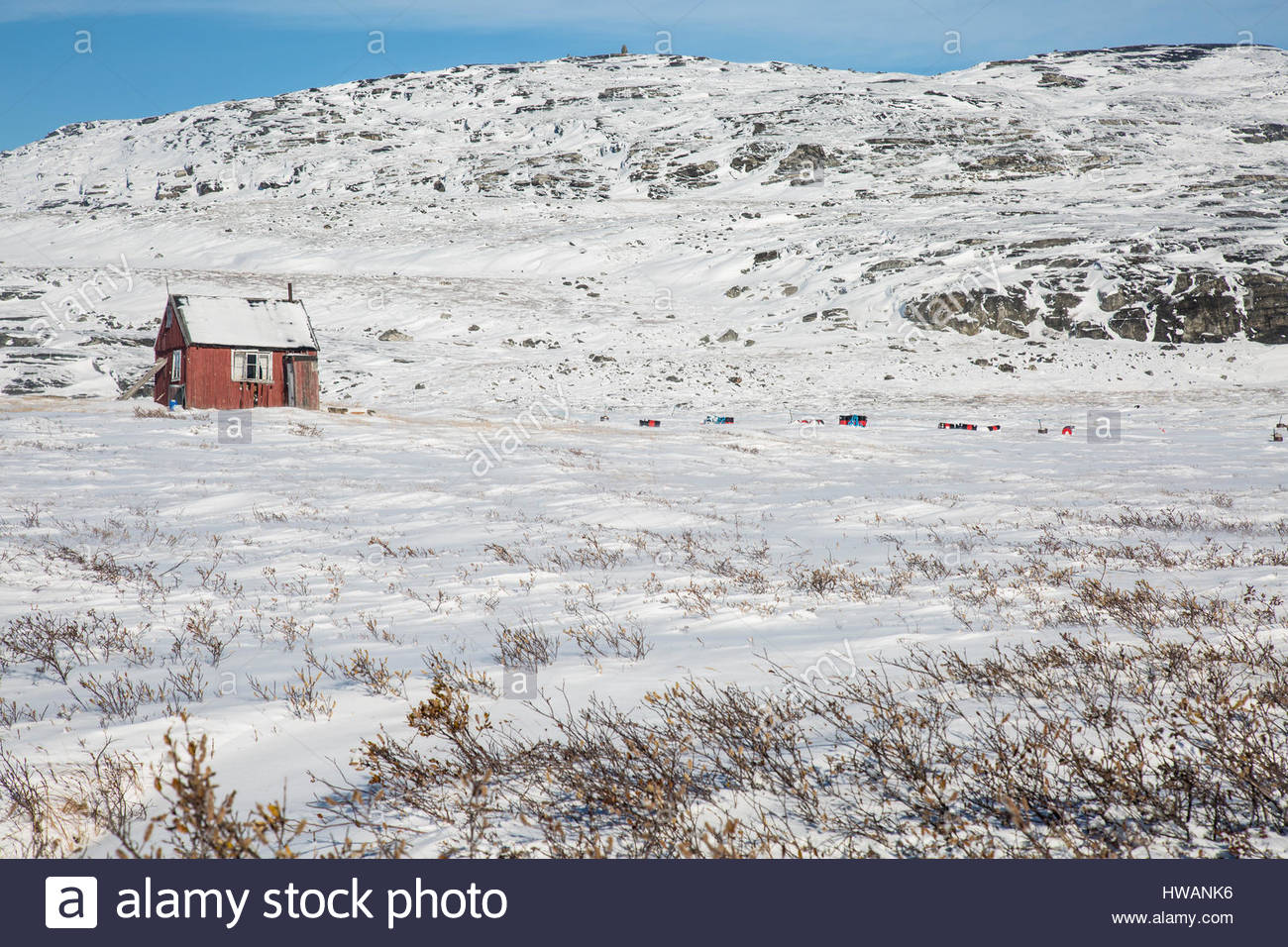 lone red greenlandic home snowy landscape Stock Photo