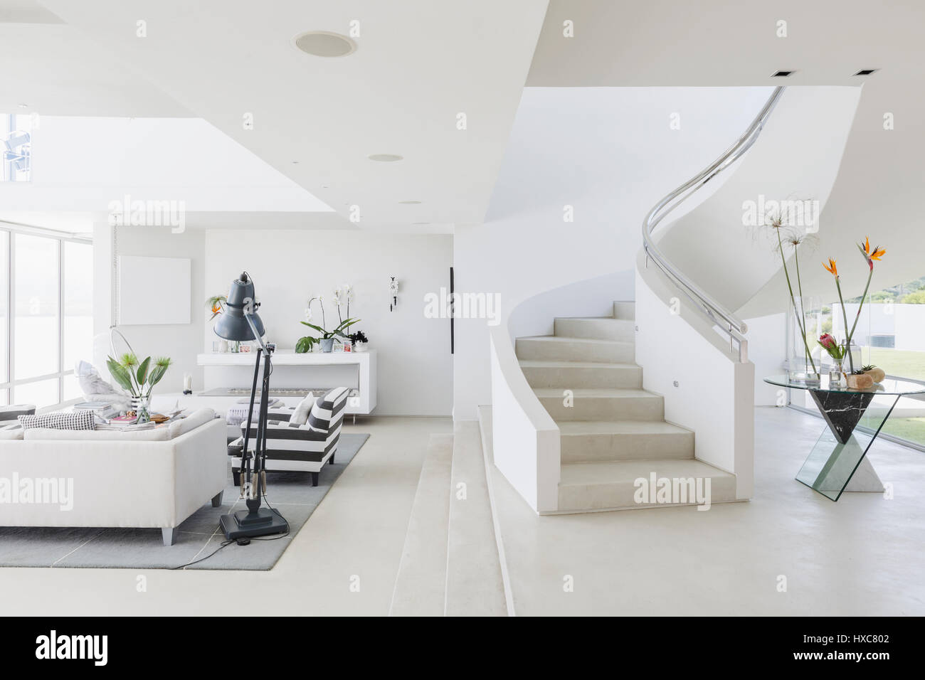 White Modern Luxury Home Showcase Spiral Staircase And Living Room Stock Photo Royalty Free