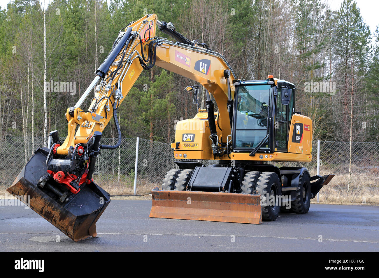LIETO FINLAND - MARCH 25 2017: Cat M318F wheeled excavator on Stock Photo Royalty Free Image