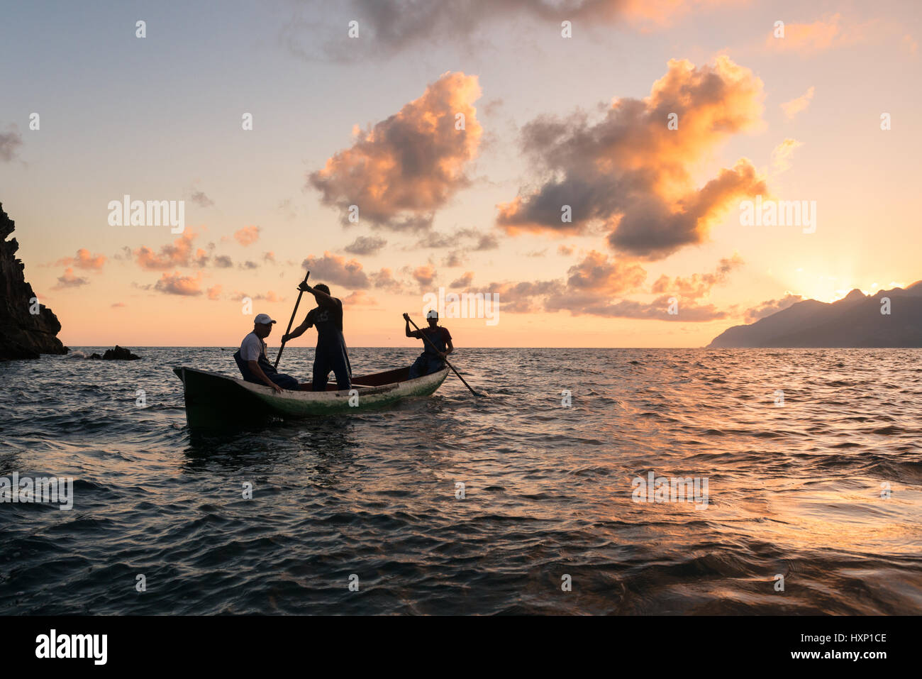 Fishermen paddling a dugout canoe off Brazil Stock Photo