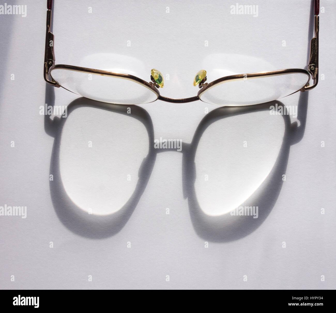 sun-shining-through-reading-spectacles-H