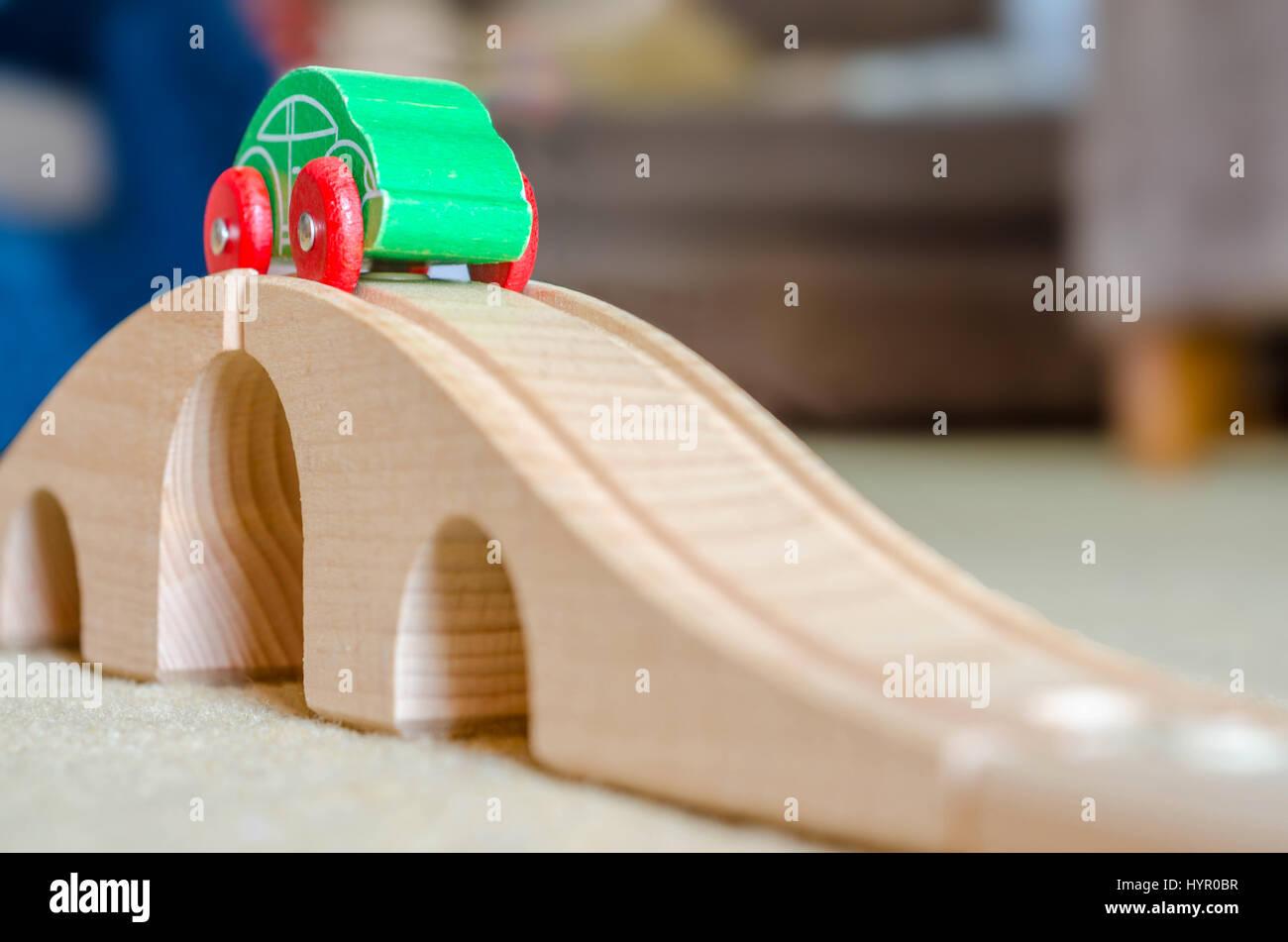 a-toy-wooden-car-on-top-of-a-toy-wooden-