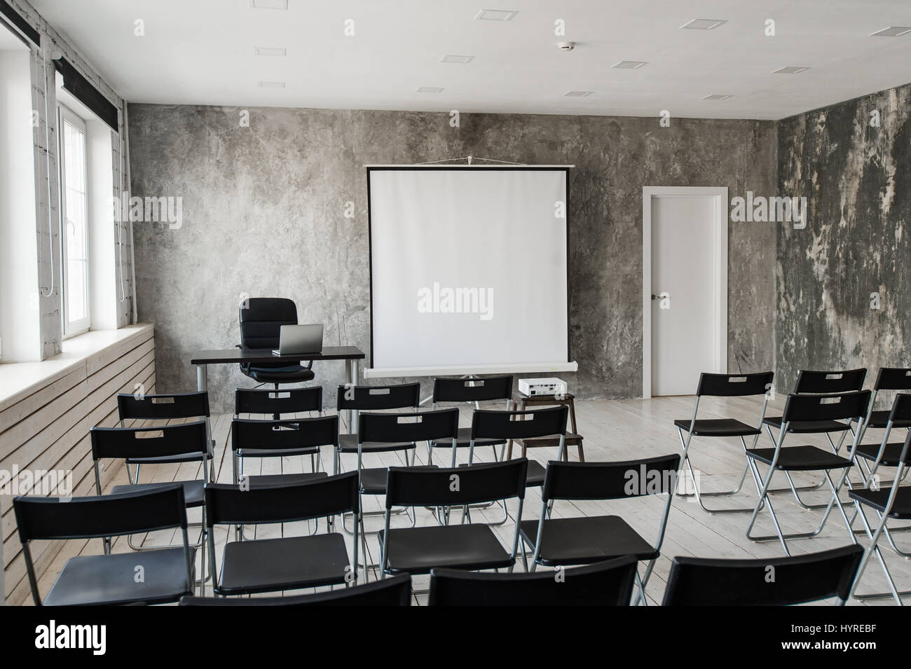 Modern Classroom Chairs ~ Empty modern classroom with black chairs projector screen