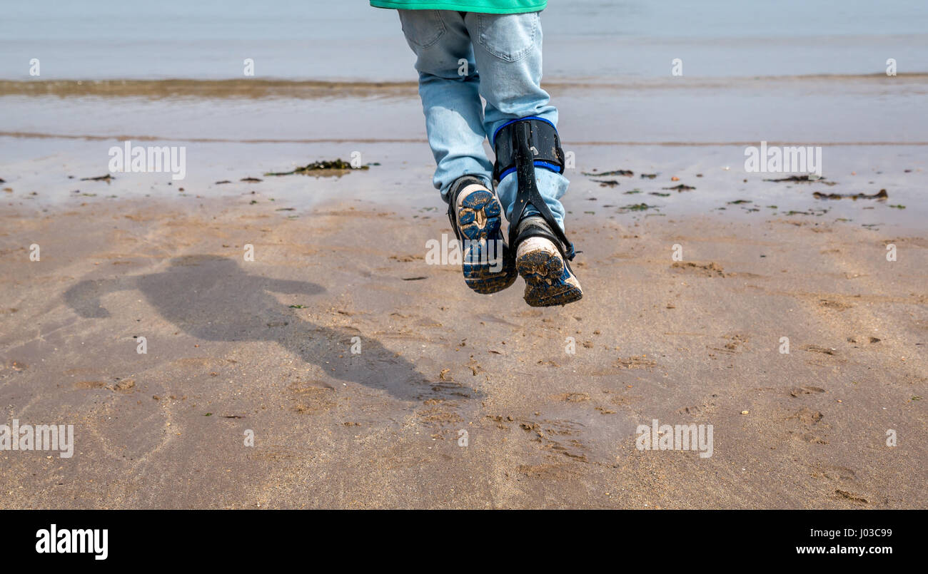 close-up-of-legs-of-a-happy-young-child-