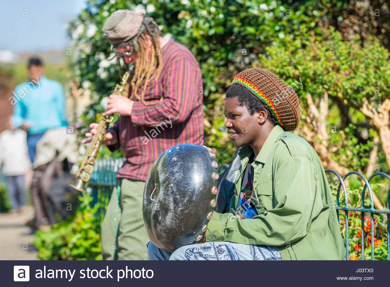 pair-of-buskers-playing-instruments-in-a