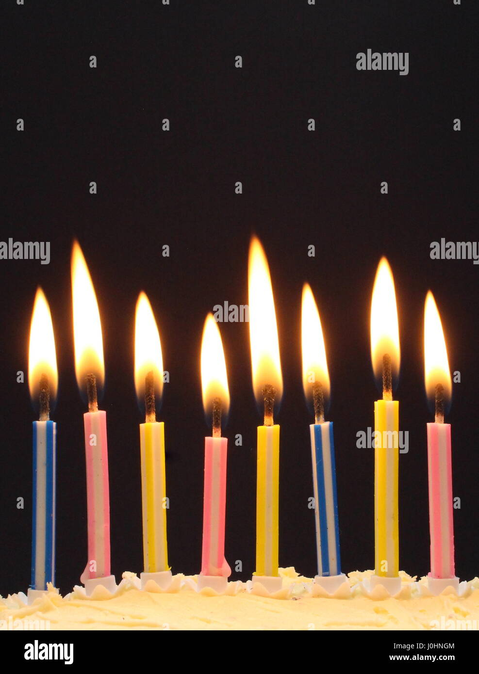 Birthday cake candles aflame Stock Photo