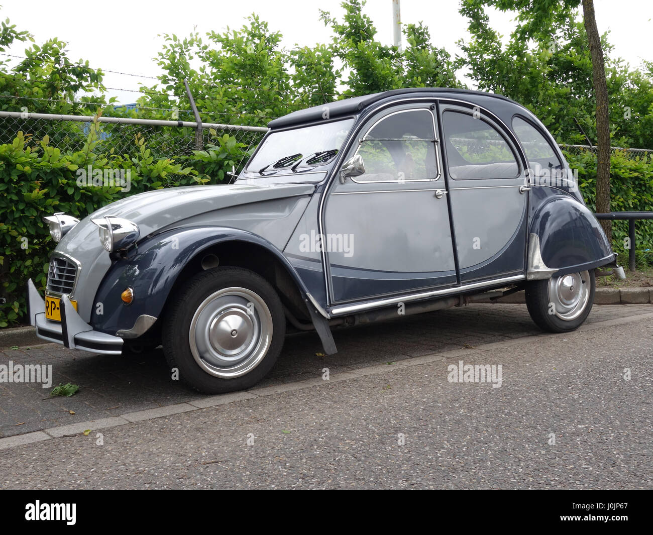 citroen 2cv deux chevaux in attractive dark and light grey colour stock photo royalty free. Black Bedroom Furniture Sets. Home Design Ideas