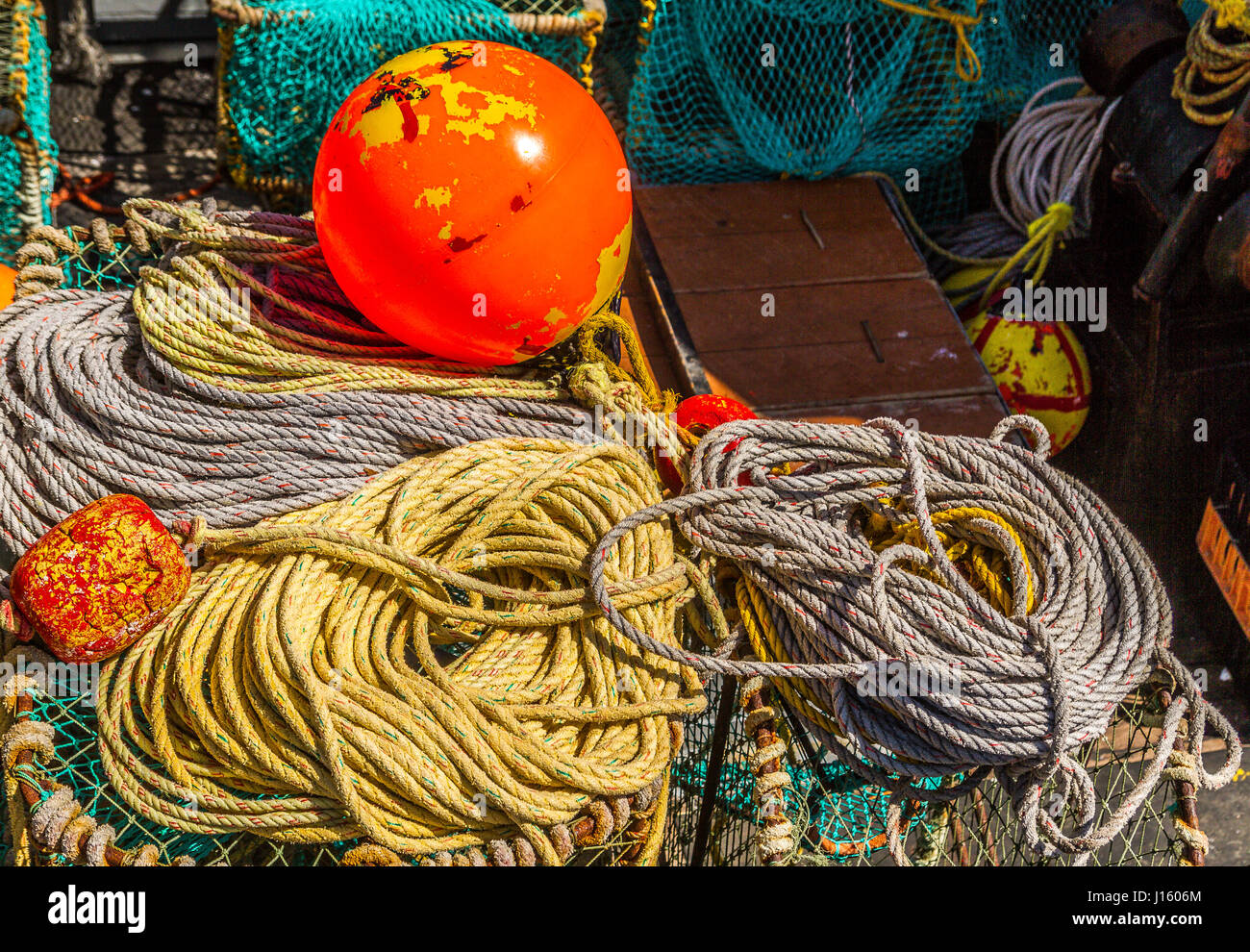 Orange buoy ropes and fishing equipment on a fishing boat for African rope fish