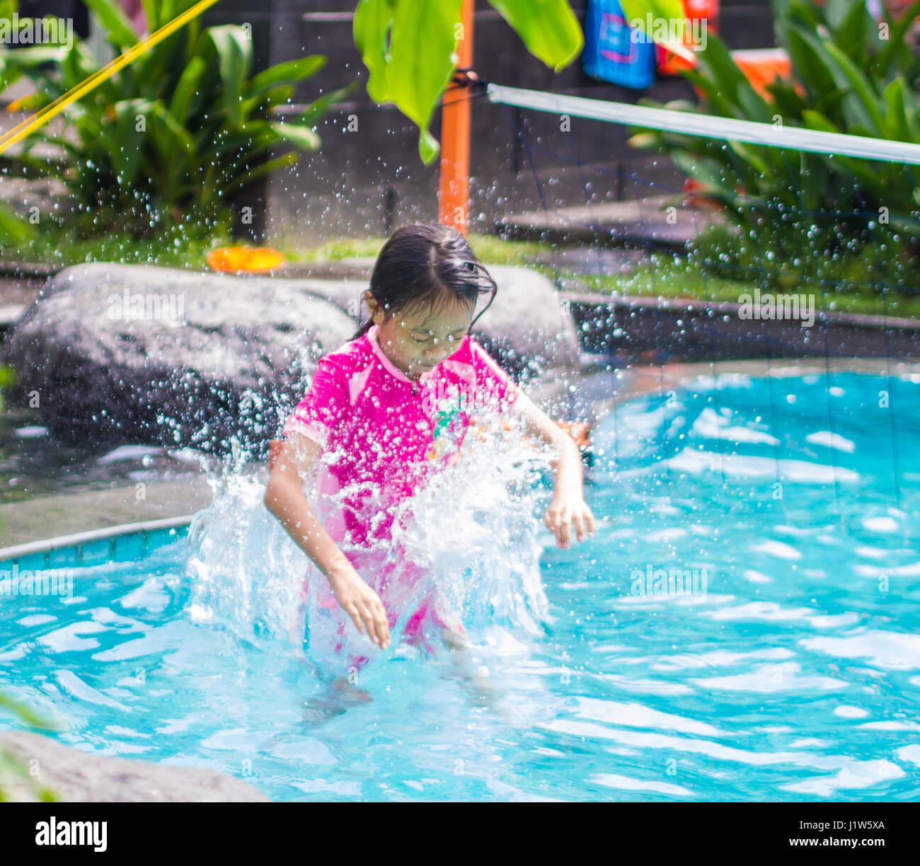 Asian Girl Jump Into Swimming Pool Stock Photo Royalty