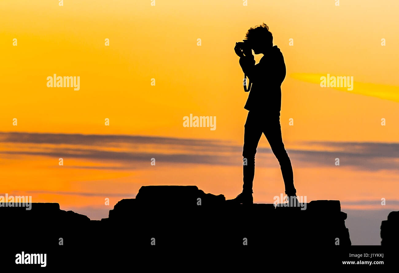 evening-photographer-silhouette-of-a-young-photographer-taking-photos-J1YKKJ.jpg