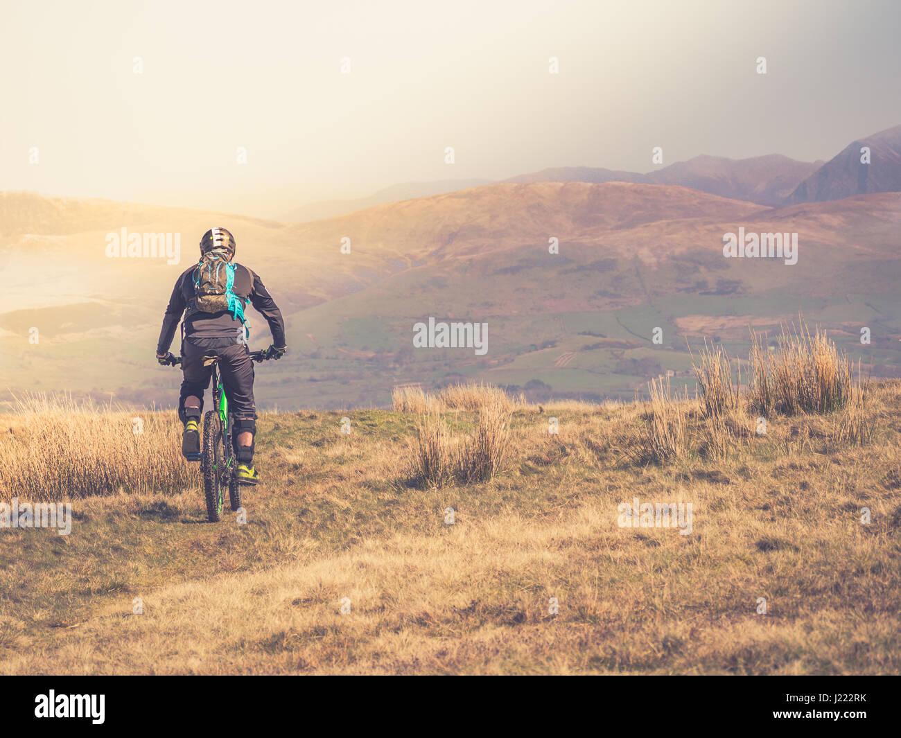 a-mountain-biker-rides-along-top-of-dent
