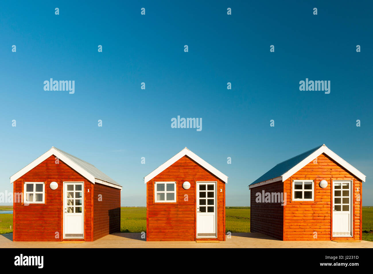 three-wood-cabins-sunny-day-lodging-hous