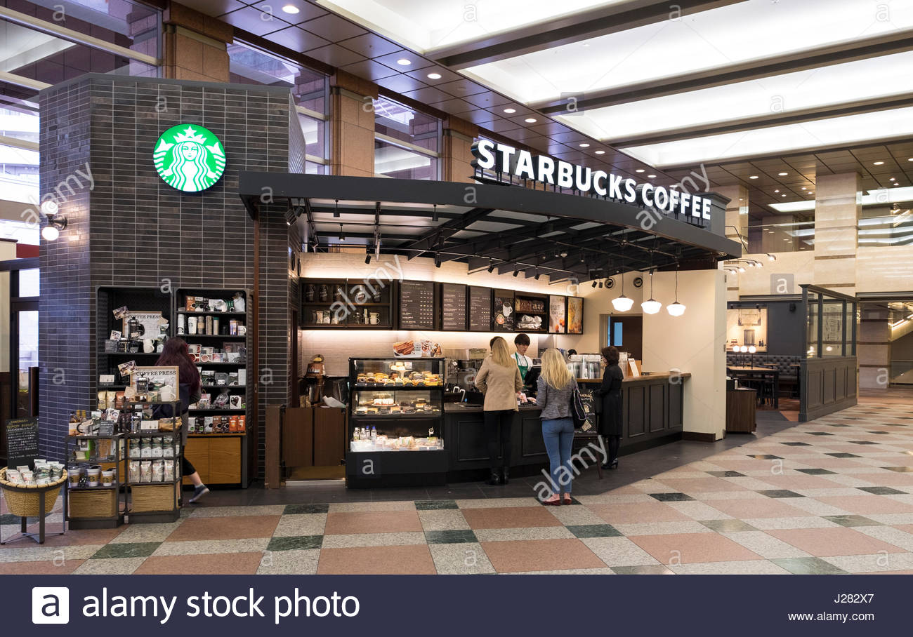 People Standing In Line At A Starbucks Coffee Kiosk Inside