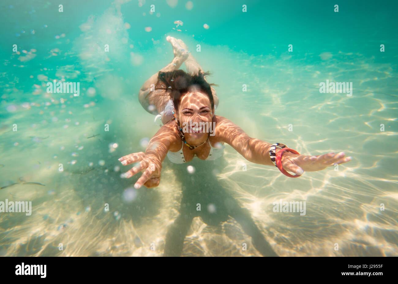 Woman diving underwater