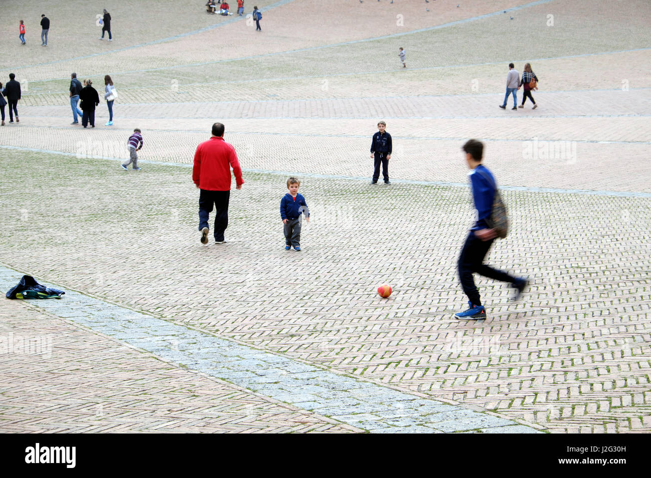street-football-young-boys-and-child-pla