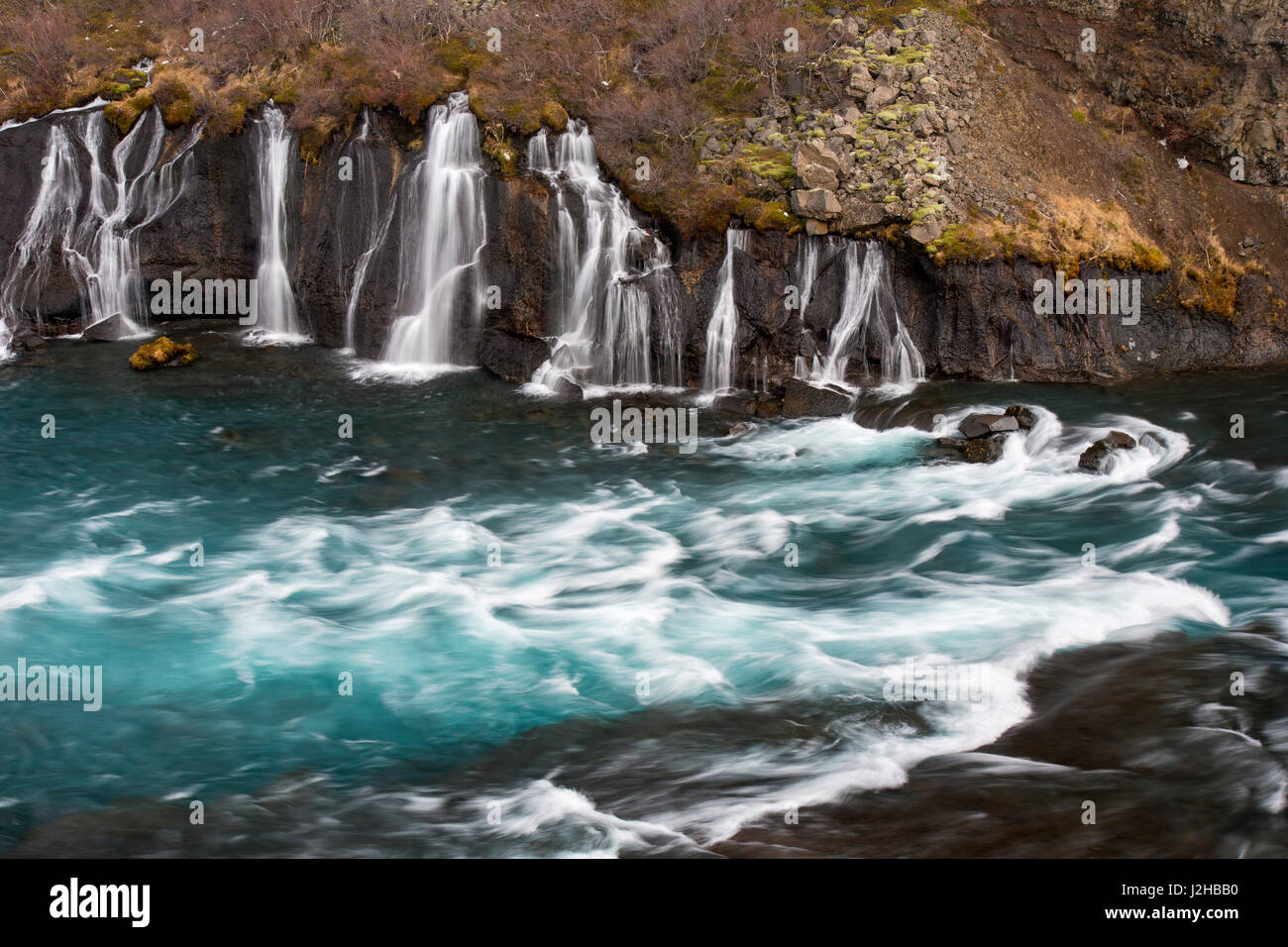 hraunfossar-series-of-waterfalls-pouring