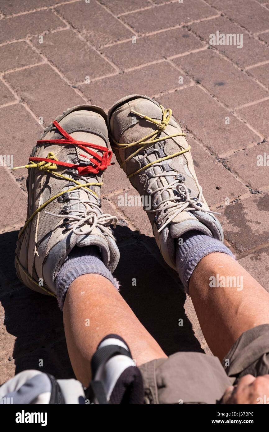 pair-of-walking-boots-with-soles-held-on