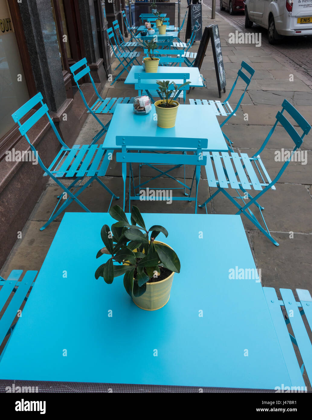 blue-tables-and-chairs-ready-for-al-fres