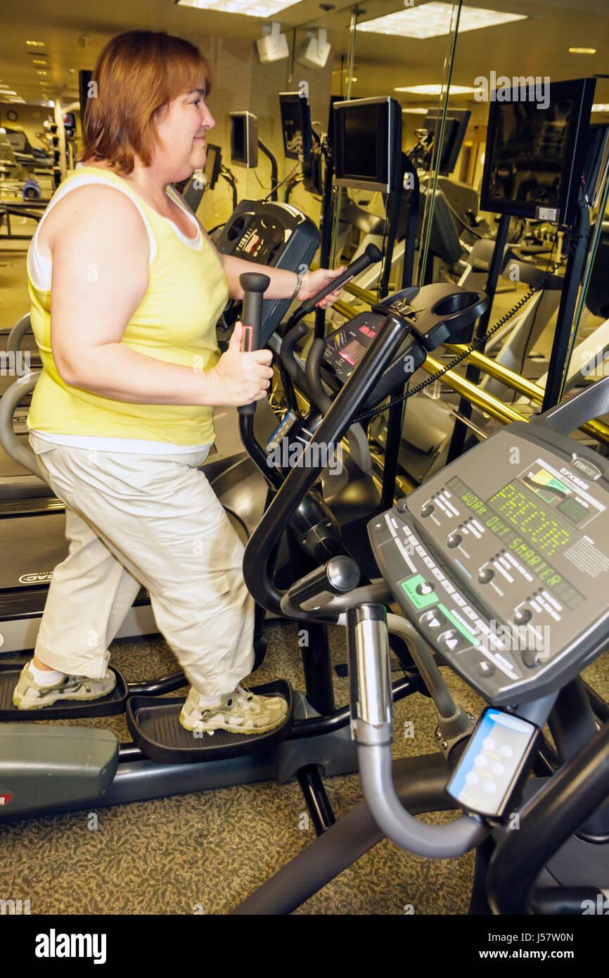 Orlando Florida International Drive The Peabody Orlando hotel health club Hispanic woman overweight fitness exercise - Stock Image