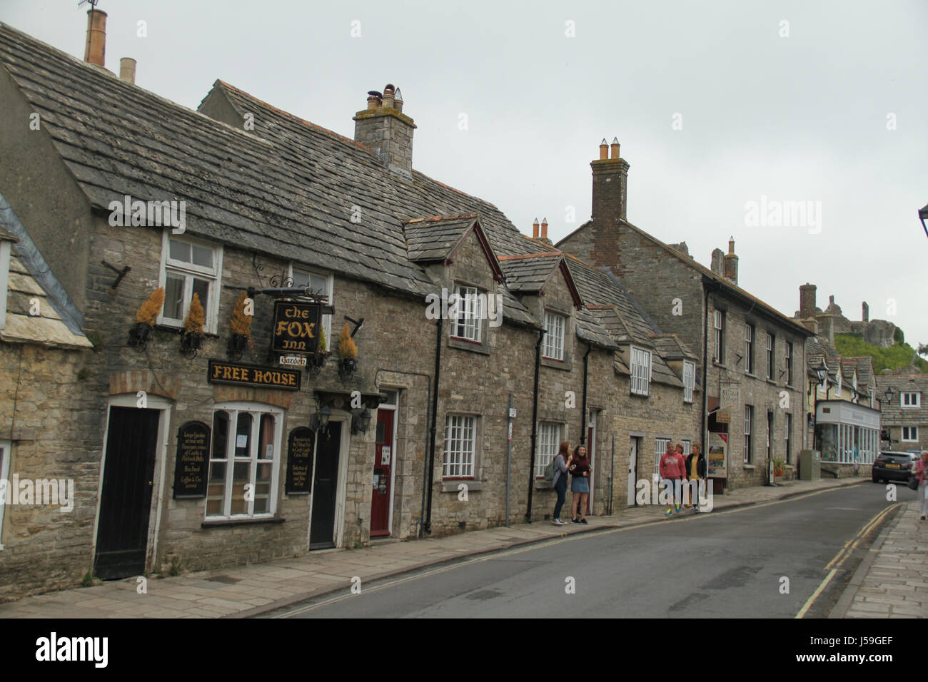 Swanage, UK -  12 May: The Fox Inn on West Street in the Corfe Castle village. The building is constructed using - Stock Image