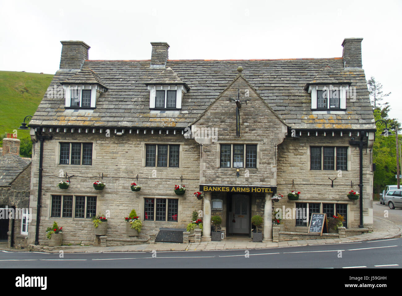 Swanage, UK -  12 May: The Bankes Arm Hotel on East Street (A351) in the Corfe Castle village. The building is constructed - Stock Image
