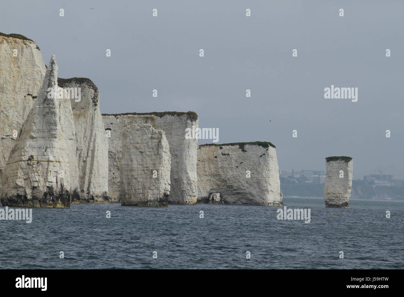 Swanage, UK -  12 May: View of the Old Harry Rocks from a boat plying the Poole Swanage route. The rocks are three - Stock Image