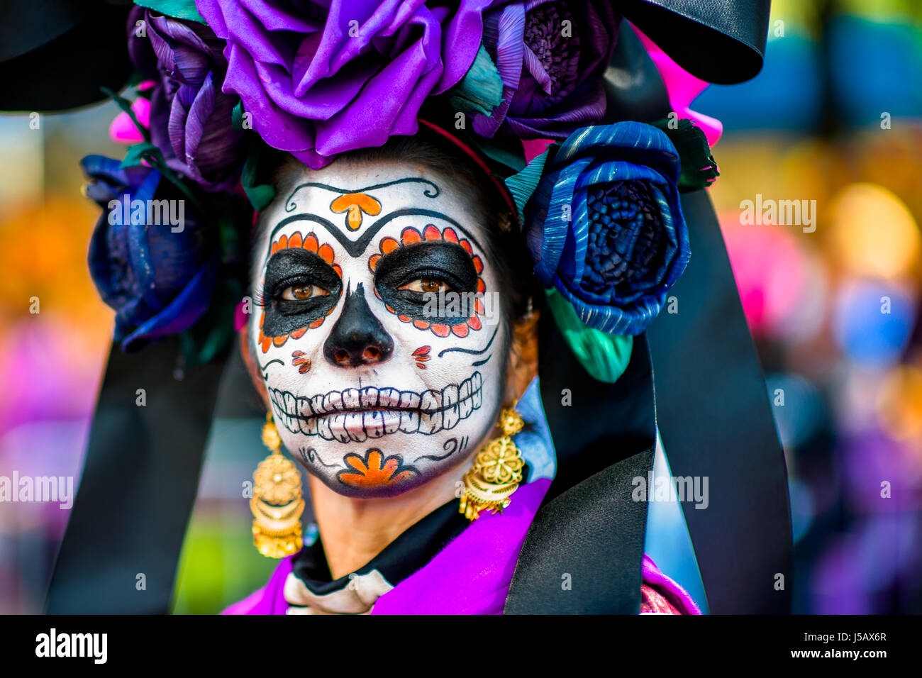 A young woman, dressed as La Catrina, performs during the Day of the Dead festival in Mexico City, Mexico. - Stock Image