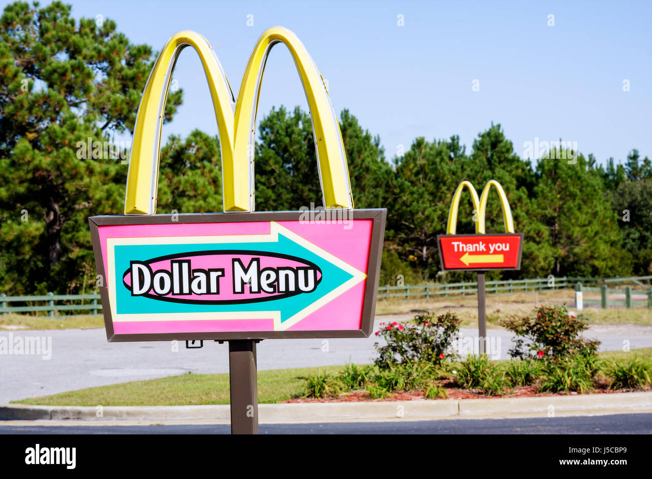 Georgia South Newport McDonald's Restaurant chain franchise fast food drive through name brand signs dollar - Stock Image