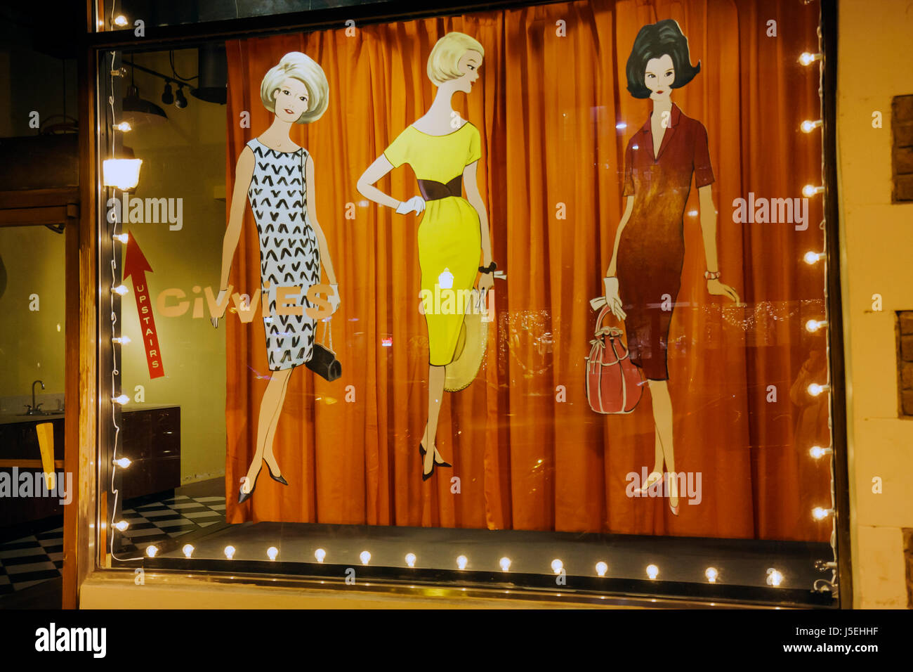 Savannah Georgia Historic District Broughton Street store window shop wood cutout fashion design 1960s sixties style - Stock Image