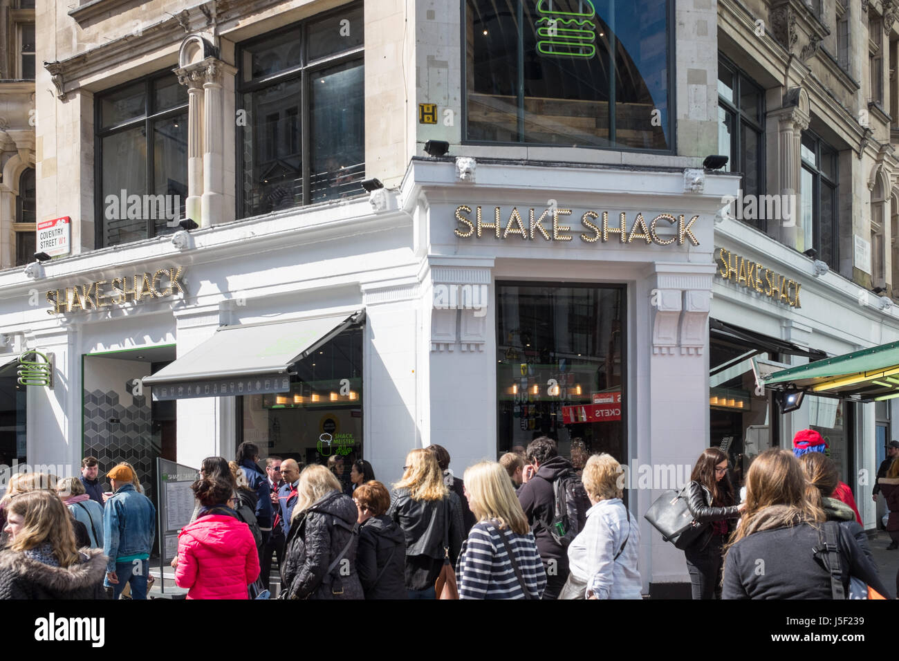 Shake Shack fast food restaurant in London's Leicester Square - Stock Image