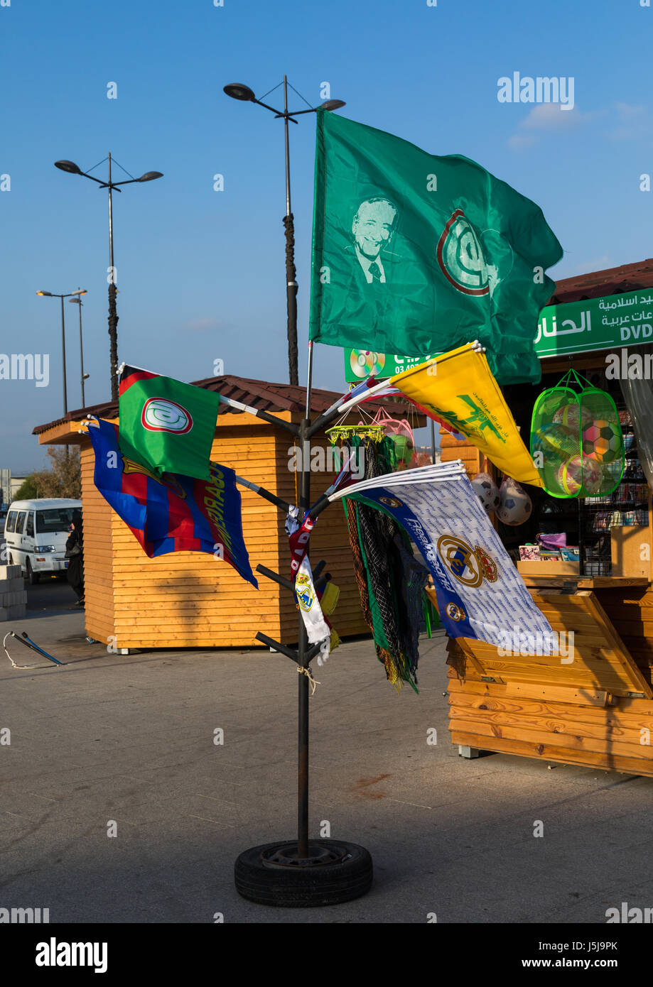 Flags with Hezbollah logo for sale with Barcelona and Madrid ones as tourist souvenirs, South Governorate, Tyre, - Stock-Bilder