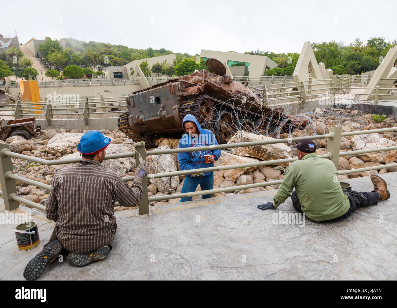 Workers painting fences in the war museum operated by Hezbollah called the tourist landmark of the resistance, South - Stock-Bilder