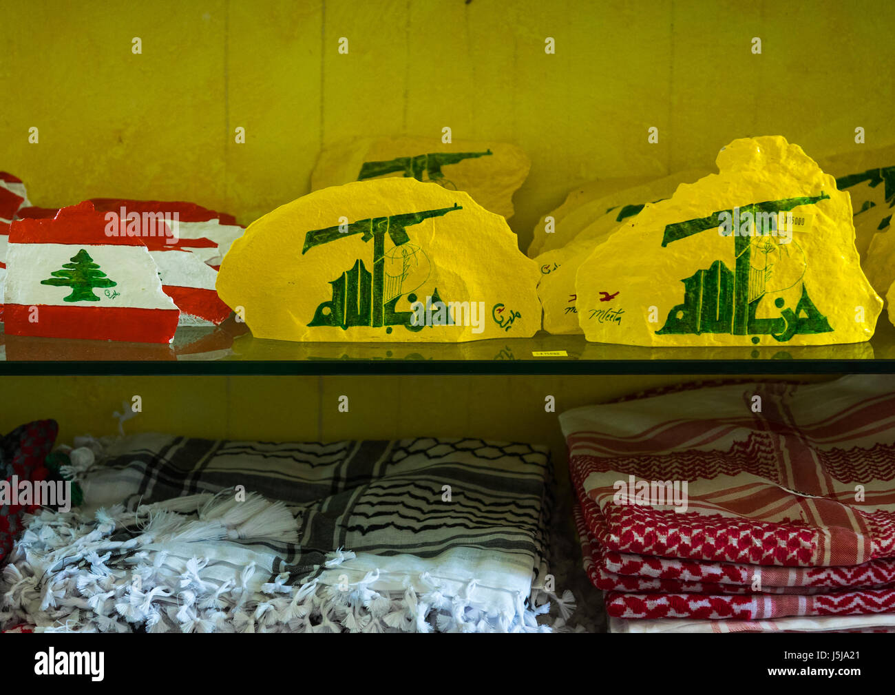 Caps for sale in the Hezbollah souvenirs shop in the tourist landmark of the resistance, South Governorate, Mleeta, - Stock-Bilder