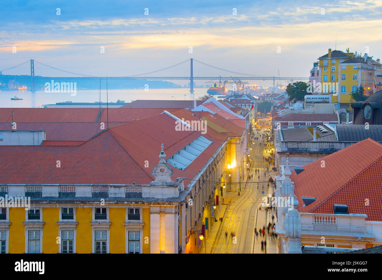 View of Old Twon of Lisbon and 25 April bridge at twilight. Portugal - Stock Image