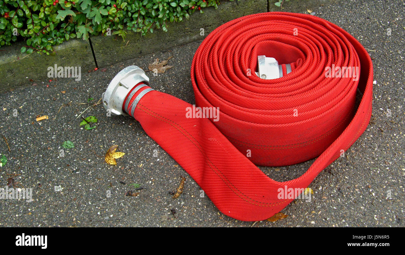 fire conflagration fire brigade hose catastrophe water hose unrolled discharge - Stock Image