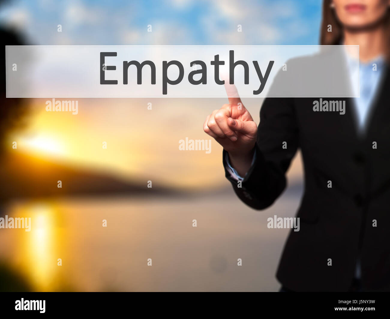 Empathy - Businesswoman hand pressing button on touch screen interface. Business, technology, internet concept. - Stock Image