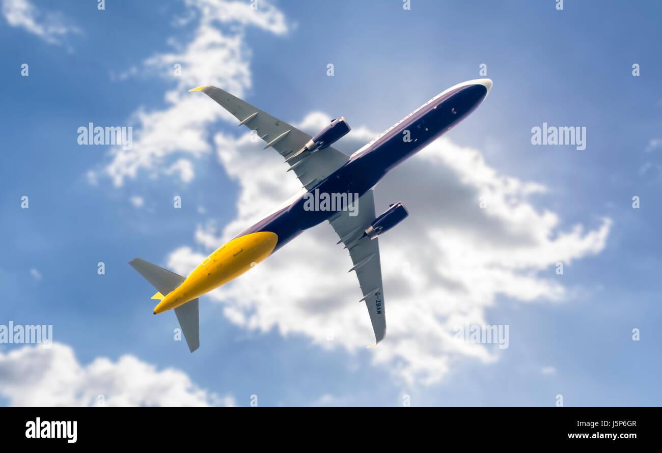 passenger-jet-aeroplane-flying-low-under