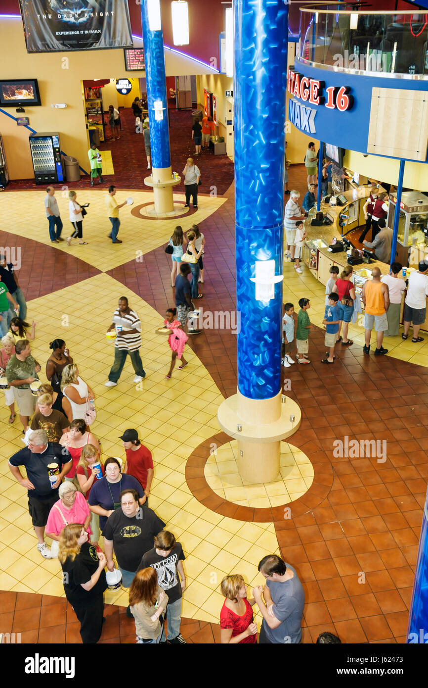 Indiana Portage Portage 16 IMAX movie theater complex lobby line overhead view columns food concession snacks families - Stock Image