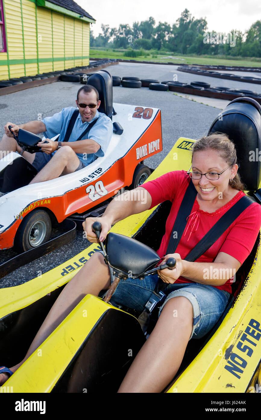 Indiana Valparaiso Zao Island Entertainment Center go kart half-scale NASCAR replica car race track drive man woman - Stock Image