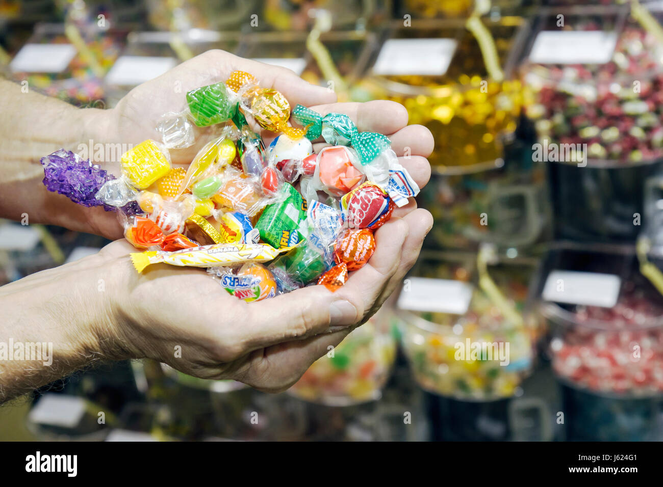 Indiana Chesterton Molly Bea's Ingredients shop food cooking baking assorted candy sugar carb handful bulk sweets - Stock Image