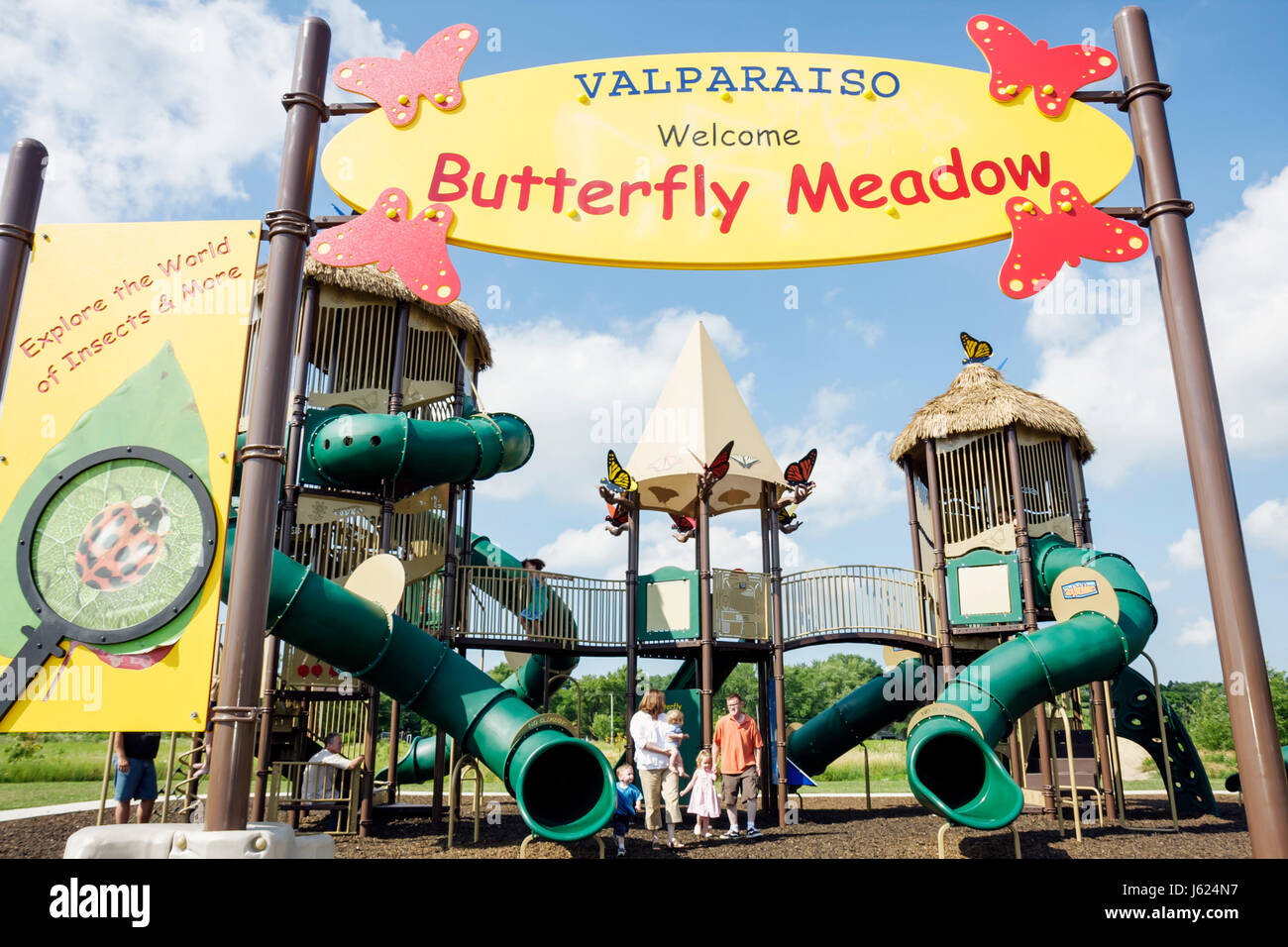 Indiana Valparaiso Butterfly Meadow theme playground slides walkways man woman boy girl baby toddler family mother - Stock Image