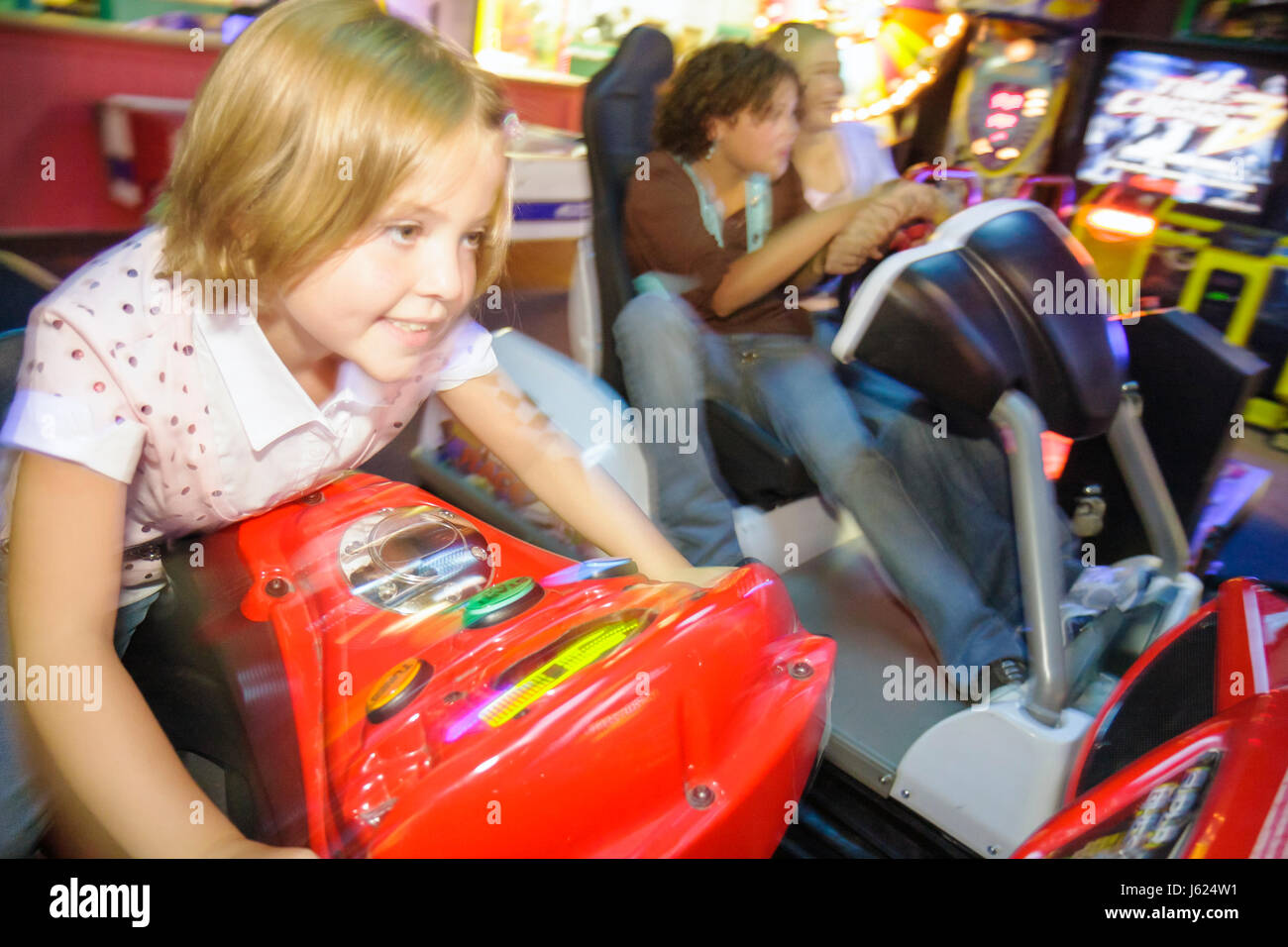 Indiana Valparaiso Inman's Fun and Party Center video game arcade game race bike simulator girl child play amusement - Stock Image