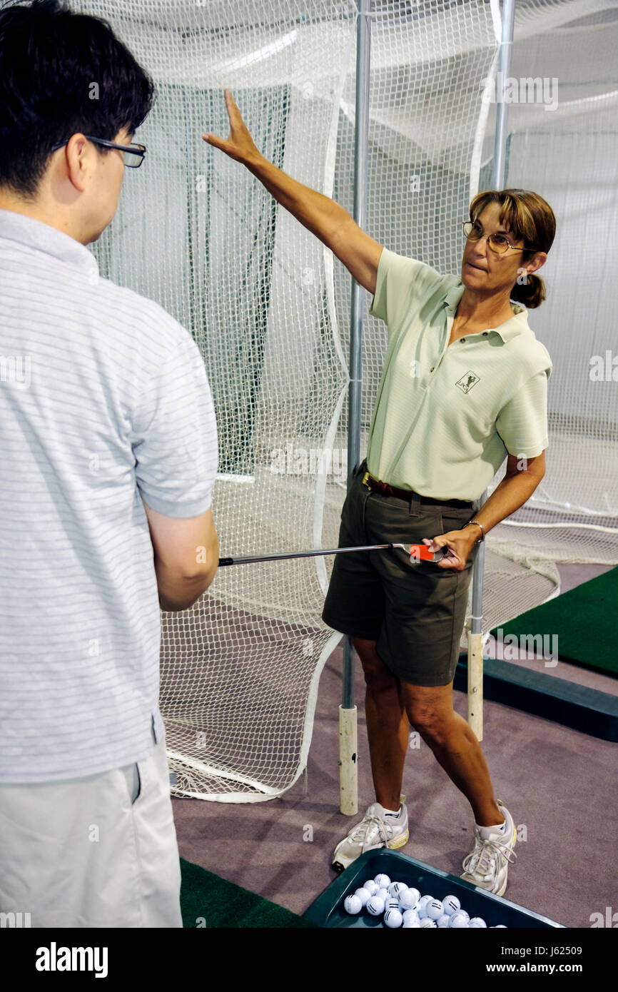 Indiana Valparaiso Creekside Golf Course and Training Center Department of Parks and Recreation man woman teach - Stock Image