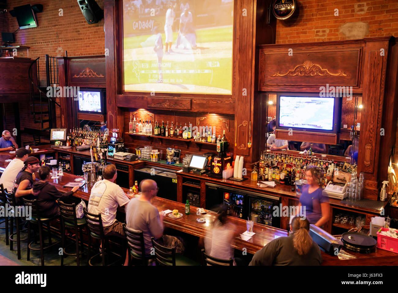 Indiana Chesterton Hooligans Pub and Grub Nightclub restaurant former china factory wood bar tv television screen - Stock Image