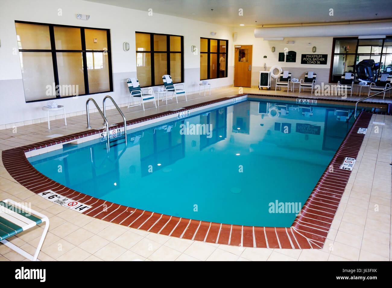 Indiana Valparaiso Holiday Inn Express motel indoor swimming pool chairs depth marker - Stock Image