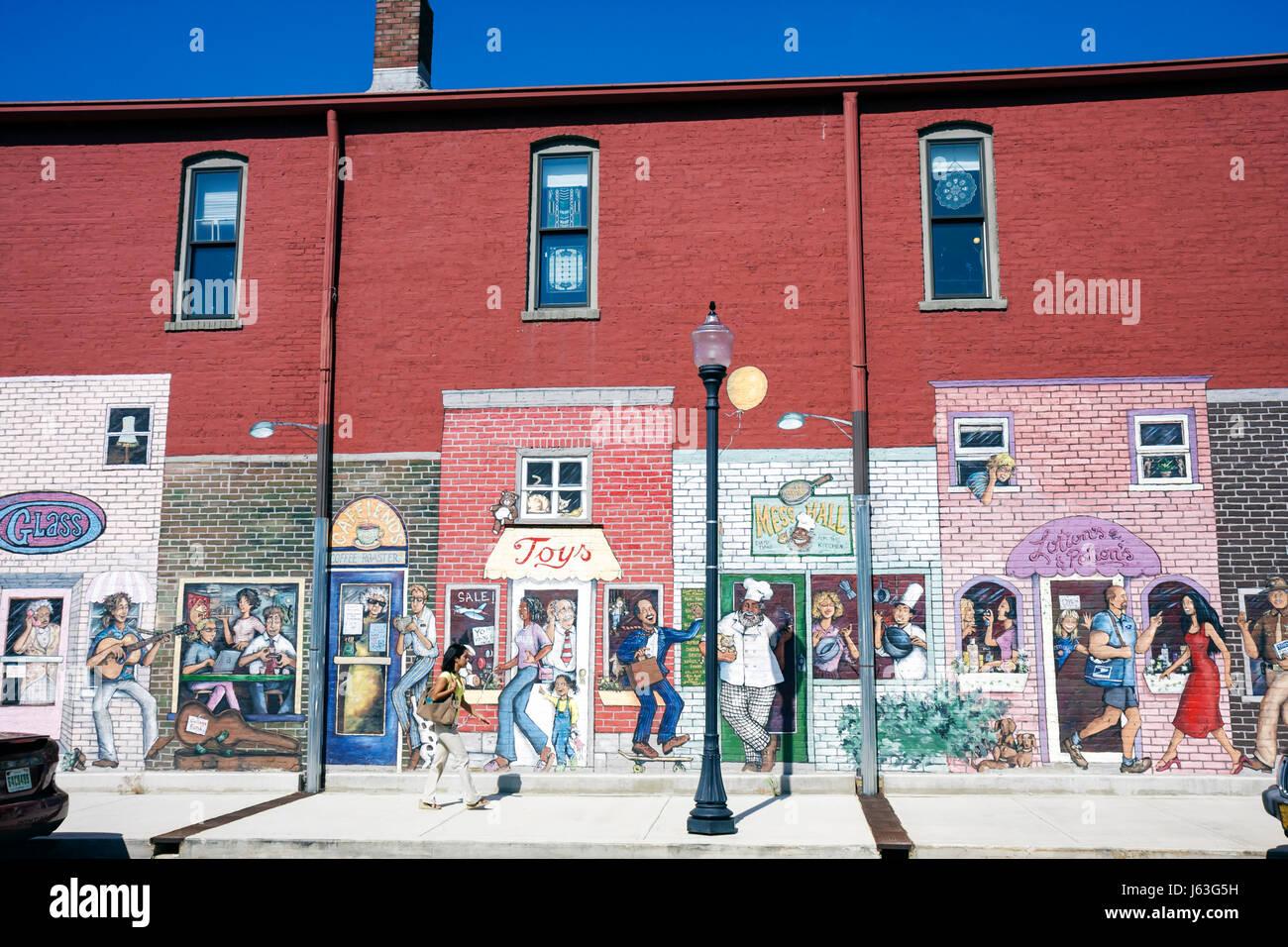 Indiana Valparaiso Michigan Avenue Lifestyles Building mural brick building sidewalk store front shops street art - Stock Image