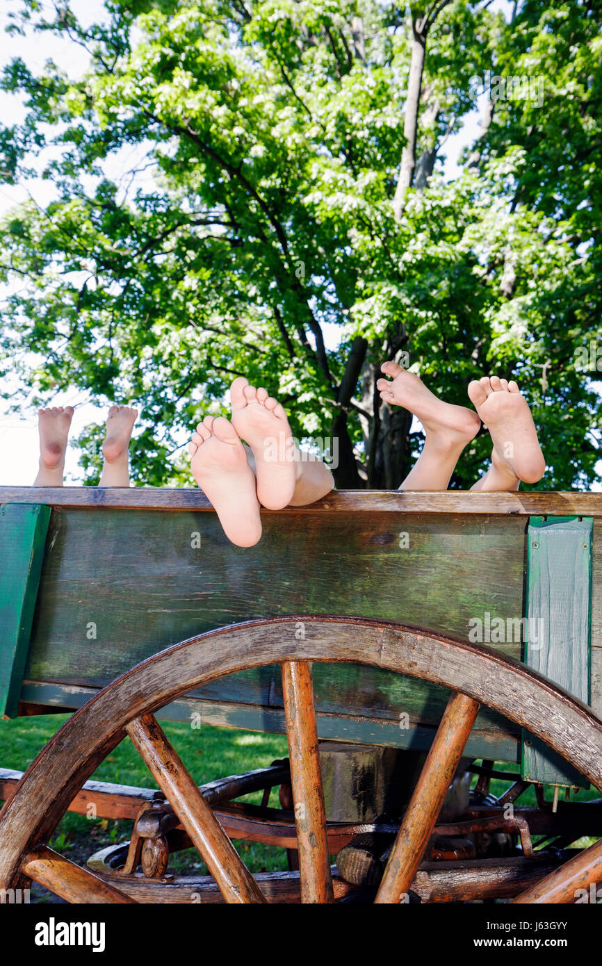 Michigan Grand Rapids Robinette Cellars cart wagon feet children barefoot bare feet - Stock Image