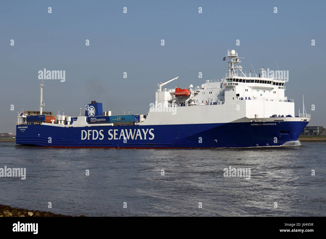 The Ro-Ro ship Anglia Seaways enters the port of Rotterdam in the canal. - Stock Image