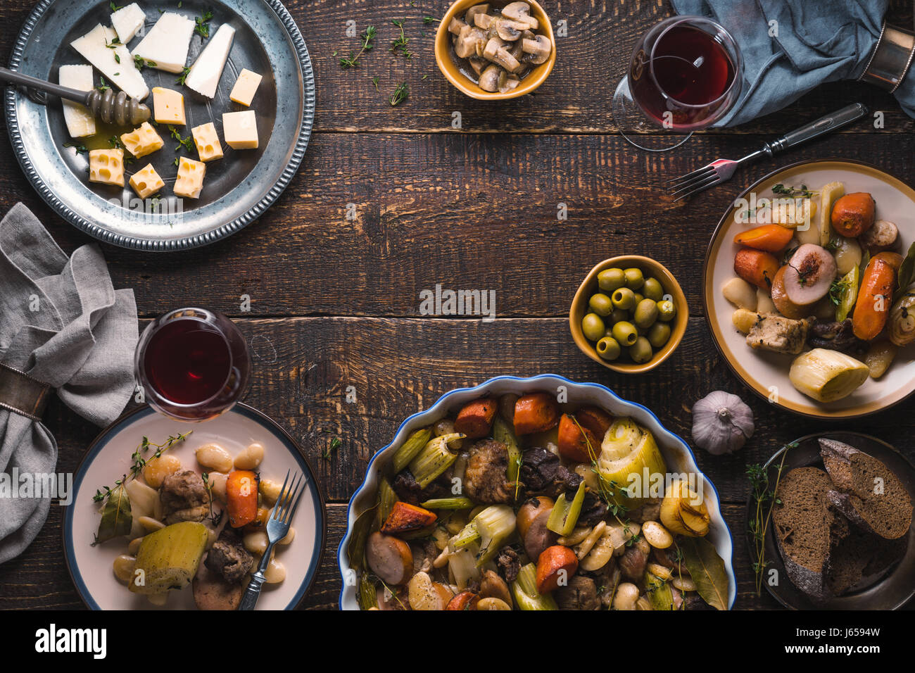 Ready-made kasul, cheese, bread, olives on the table free space - Stock Image