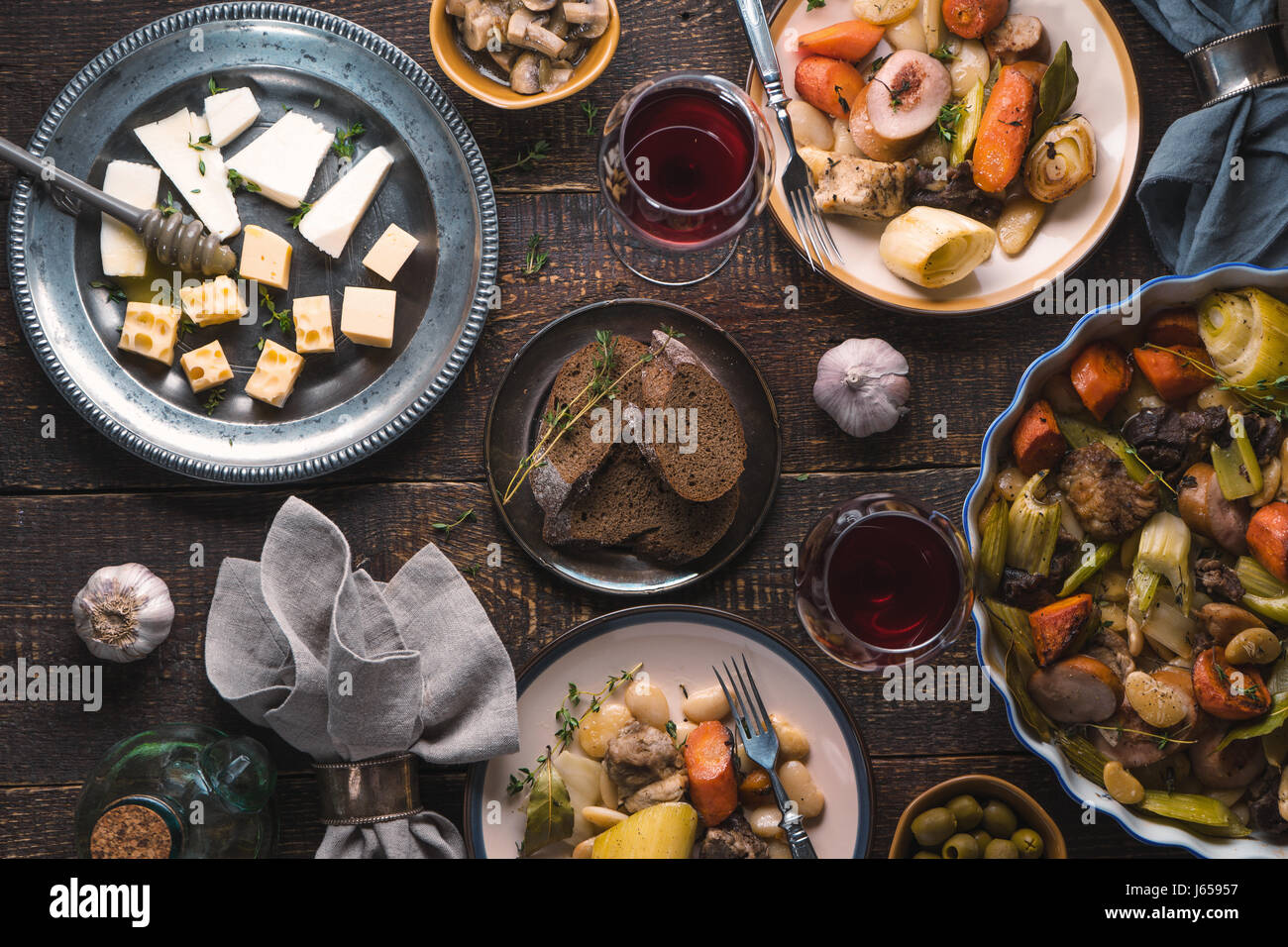 Feast with kasul, cheese, bread, olives and wine - Stock Image